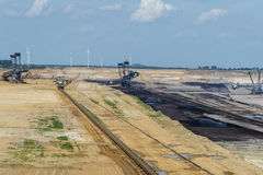 Open pit and diggers Royalty Free Stock Photography