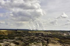 Open-pit lignite mining. Open-pit mining for lignite (brown coal) that is burnt and transformed to electricity by the power station at the horizon - largest royalty free stock photos