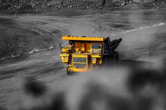 Free Open Pit Mine Industry. Yellow Mining Truck For Coal Moves Along Dusty Quarry Road Royalty Free Stock Image - 195056156