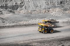 Free Open Pit Mine Industry. Yellow Mining Truck For Coal Moves Along Dusty Quarry Road Stock Photos - 195957203