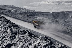 Free Open Pit Mine Industry. Yellow Mining Truck For Coal Moves Along Dusty Quarry Road Royalty Free Stock Photo - 195968275