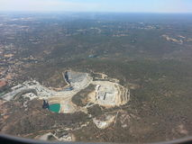 Open pit mine quarry from the air out of Plane window Stock Photo