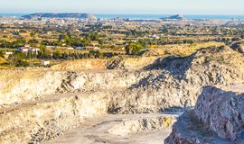 Open-pit mining excavation. Panoramic views of Alicante`s orchard and with the background the Mediterranean Sea Stock Image