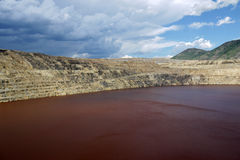 Open Pit Mining Superfund Site. Once the world's largest open pit copper mine, the Berkley Pit in Butte, MT is now closed and in the process of being cleaned up stock images