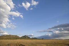 Open plains of Tsavo East National Park, Kenya. Open plains of Tsavo East under a striking sky, National Park, Kenya royalty free stock photos