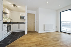 Open plan apartment. Modern open plan apartment with smart kitchen stock image