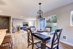 Open plan dining room interior with light wood floors Royalty Free Stock Image