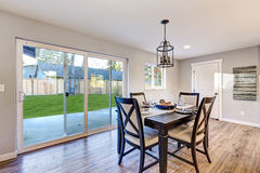 Open plan dining room interior with light wood floors Stock Photography