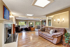 Open plan family room with hardwood floor Stock Photography