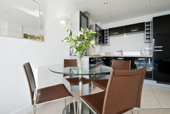 Open plan kitchen. With dining table and four seats royalty free stock images