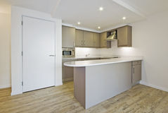 Open plan kitchen. Modern open plan kitchen with smart counter and built in electric appliances stock images
