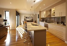 Open-Plan Kitchen. Modern open-plan kitchen, dining and living area, with granite benchtops and polished floorboards Stock Photo