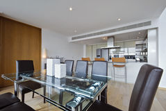 Open plan kitchen with dining area. Contemporary high spec dining area with open plan kitchen view Stock Photo