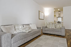 Open plan living room. Fully furnished open plan living room with two linen sofas Stock Photos