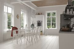 Open-plan white kitchen and dining room interior Stock Photo
