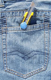 Open pocket knife in blue jeans Stock Photo