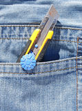 Open pocket knife in blue jeans Stock Photography