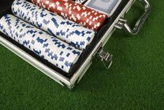 Open Poker Case. A open poker case on a green table Stock Image