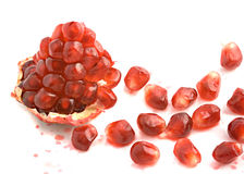 Open pomegranate and arils. Isolated on white background Royalty Free Stock Photos