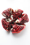 Open pomegranate on gray background Royalty Free Stock Image