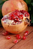 Open pomegranate with seeds Royalty Free Stock Images