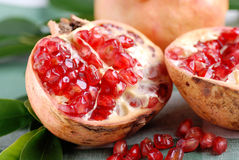 Open pomegranate with seeds Stock Photography