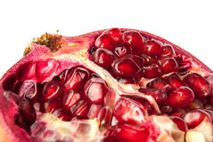 Open pomegranate  on white. Open pomegranate on a white background, macro Stock Photos