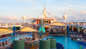 Open pool deck of the large cruise ship during sunset time. Stock Photos