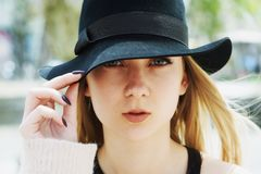 Open portrait of a young woman in a hat close-up royalty free stock photography
