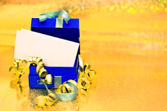 Open present box on golden background. Beautiful present box on golden shining surface Royalty Free Stock Image