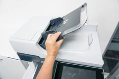 Open the printer document feeder. Open the automatic document feeder of the printer Stock Photo