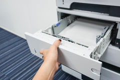 Open the printer tray. To put the paper Stock Photo