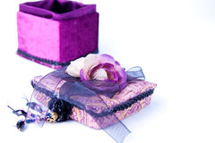 Open purple gift box with a rose isolated. Stock Image