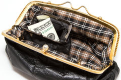 In an open purse is the purse with the dollars. Stock Images
