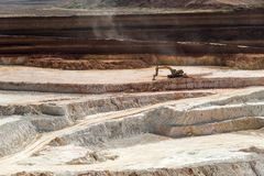 Open quarry for the extraction of kaolin Stock Photos