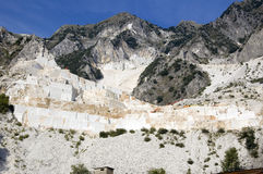 Open quarry of white marble. An open quarry of white marble in Carrara, Tuscany, Italy Royalty Free Stock Photo