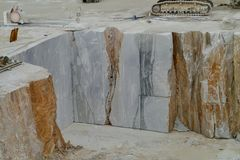 An open marble pit mine in Carrara in Italy Royalty Free Stock Photography