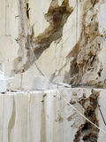 Open quarry of white marble. Sheer wall of an open quarry of white marble on the east coast of Sardinia, Orosei Stock Image