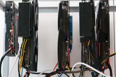 Open rack for cryptocurrency mining includes graphics cards, motherboard and hard drive royalty free stock photography