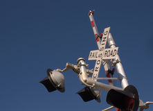 Open railroad crossing sign. With warning lights, blue sky background Royalty Free Stock Photos