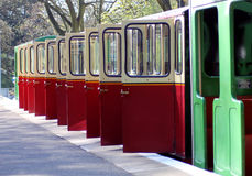 Open railway carriage doors. Of miniature train on platform Royalty Free Stock Images