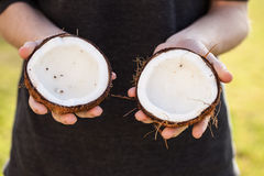 Open raw coconut being held Royalty Free Stock Images