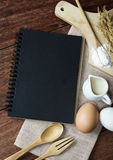 Open recipe book on wooden table with copy space. Top view Stock Image