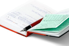 Open daily records. Opened notepad to record. Isolated on a white background Royalty Free Stock Photography