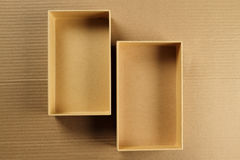 Open Recycled Card Board Box on Corrugated Background Stock Photos
