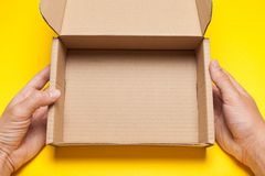 Open recycled parcel address delivery box, brown postal carton paper royalty free stock images
