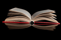 Open red book. One open red book isolated on a black background Royalty Free Stock Photography