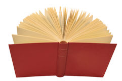 Open red book isolated. Open red book with yellow pages, isolated white background Royalty Free Stock Photos