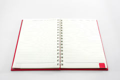 Open red book with lines. Stock Photos