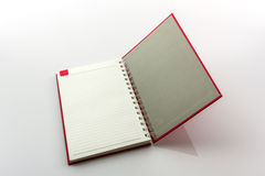 Open red book with lines. Royalty Free Stock Image